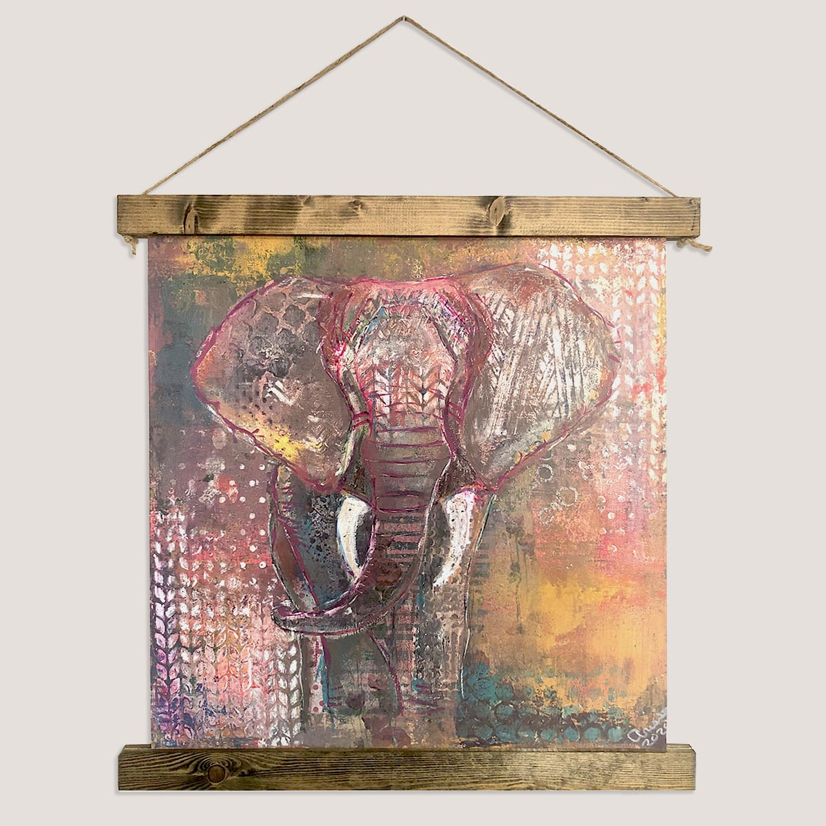 Hanging custom canvas photo print with wood frame of a painted elephant designed by JKCC custom printing and design shop in Paola KS