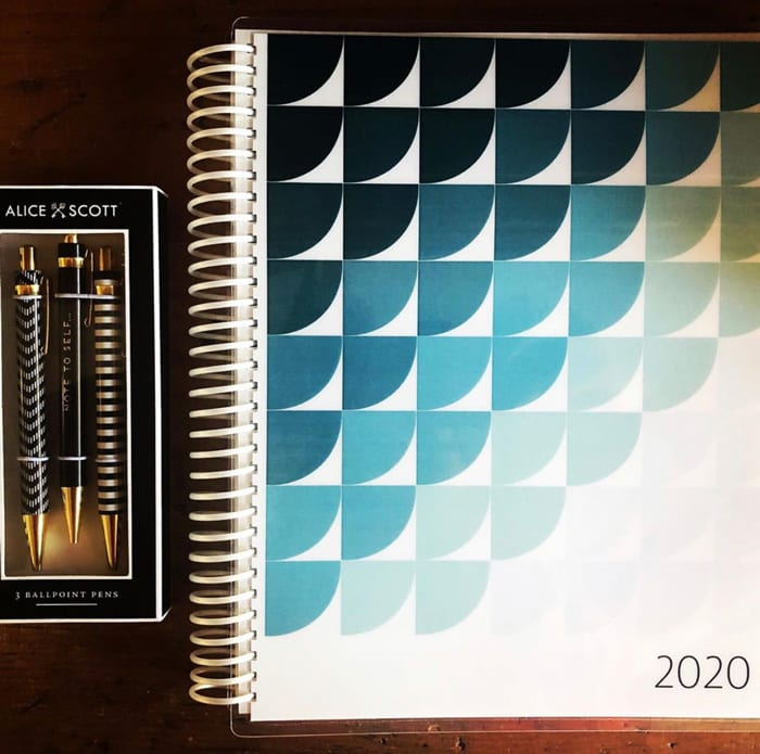 A custom planner with spiral binding designed and printed at JKCC custom printing and design shop in Paola Kansas